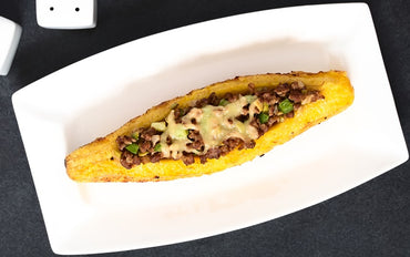 85 - Ripe Plantains Stuffed with Meat & Vegetables / Canoa de Amarillo con Carne & Vegetales