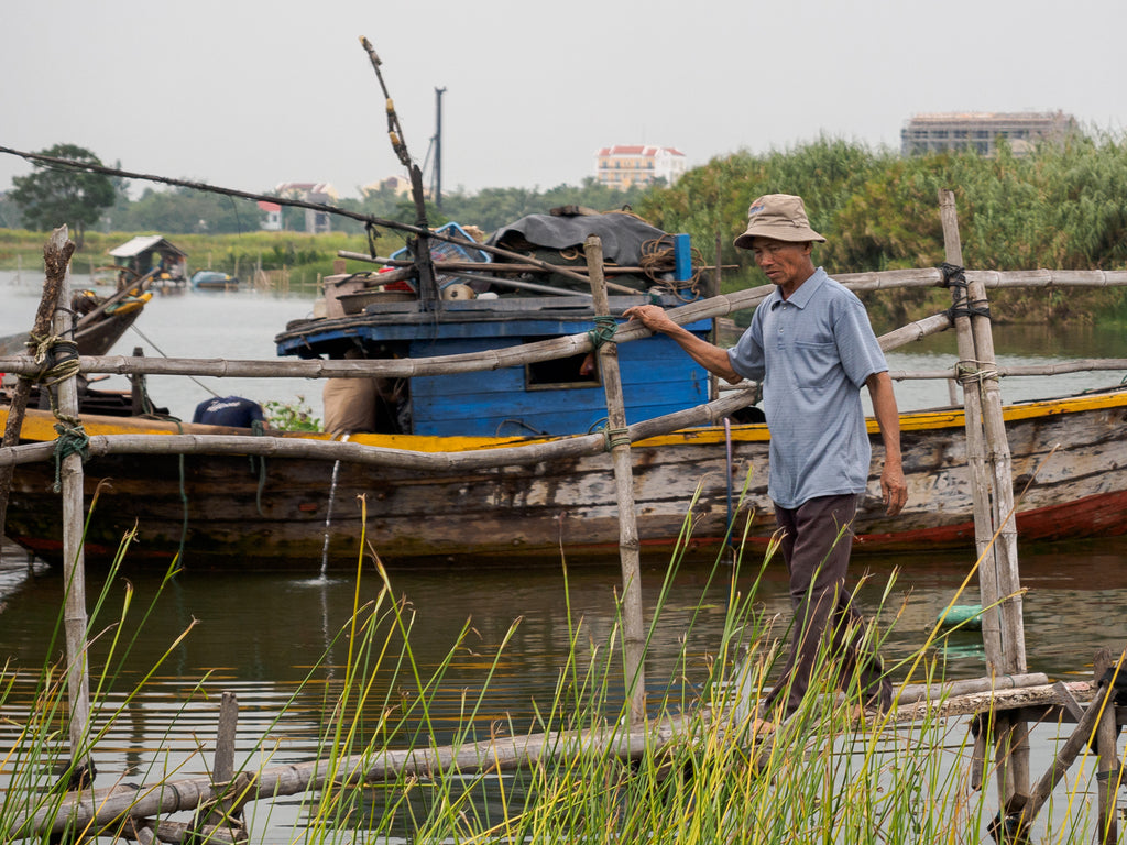 Man crossing a bridge in Hoi An Vietnam