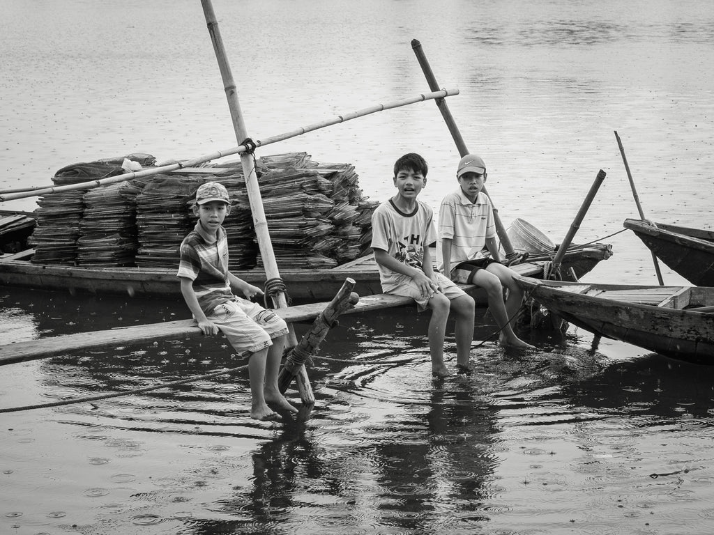 Boys on a dock in Hoi An Vietnam