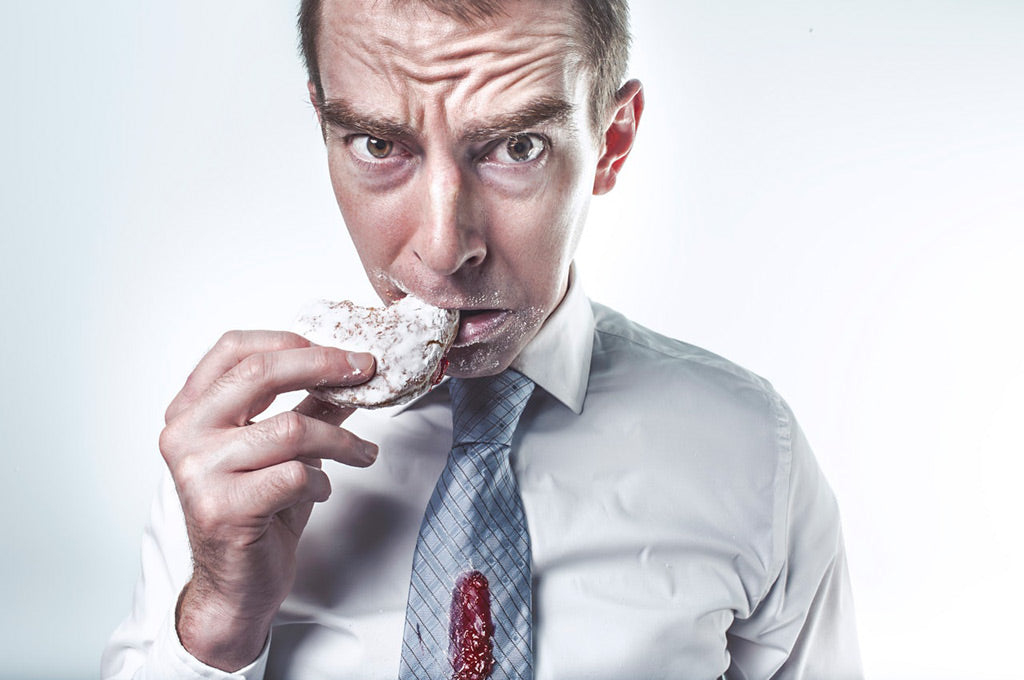 man eating a donut