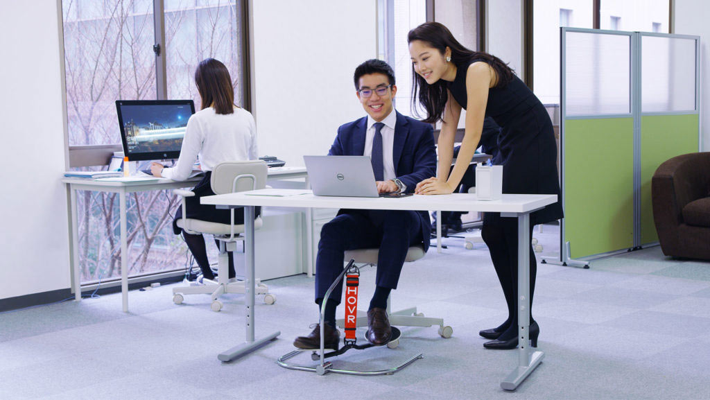 office employees using hovr desk swing at work
