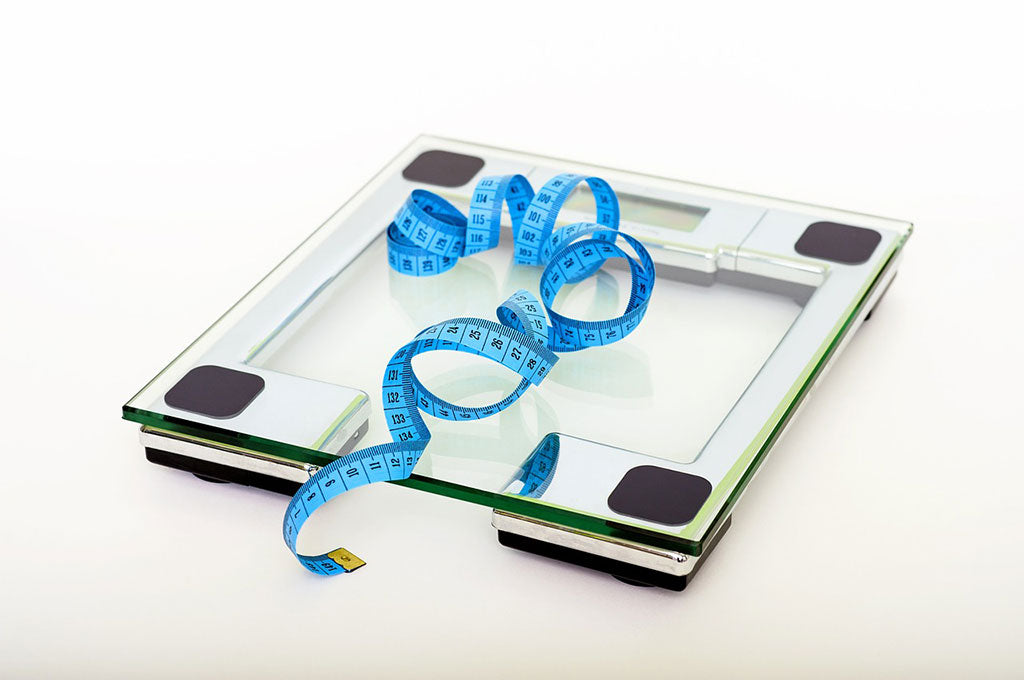 weighing scale with blue measuring tape