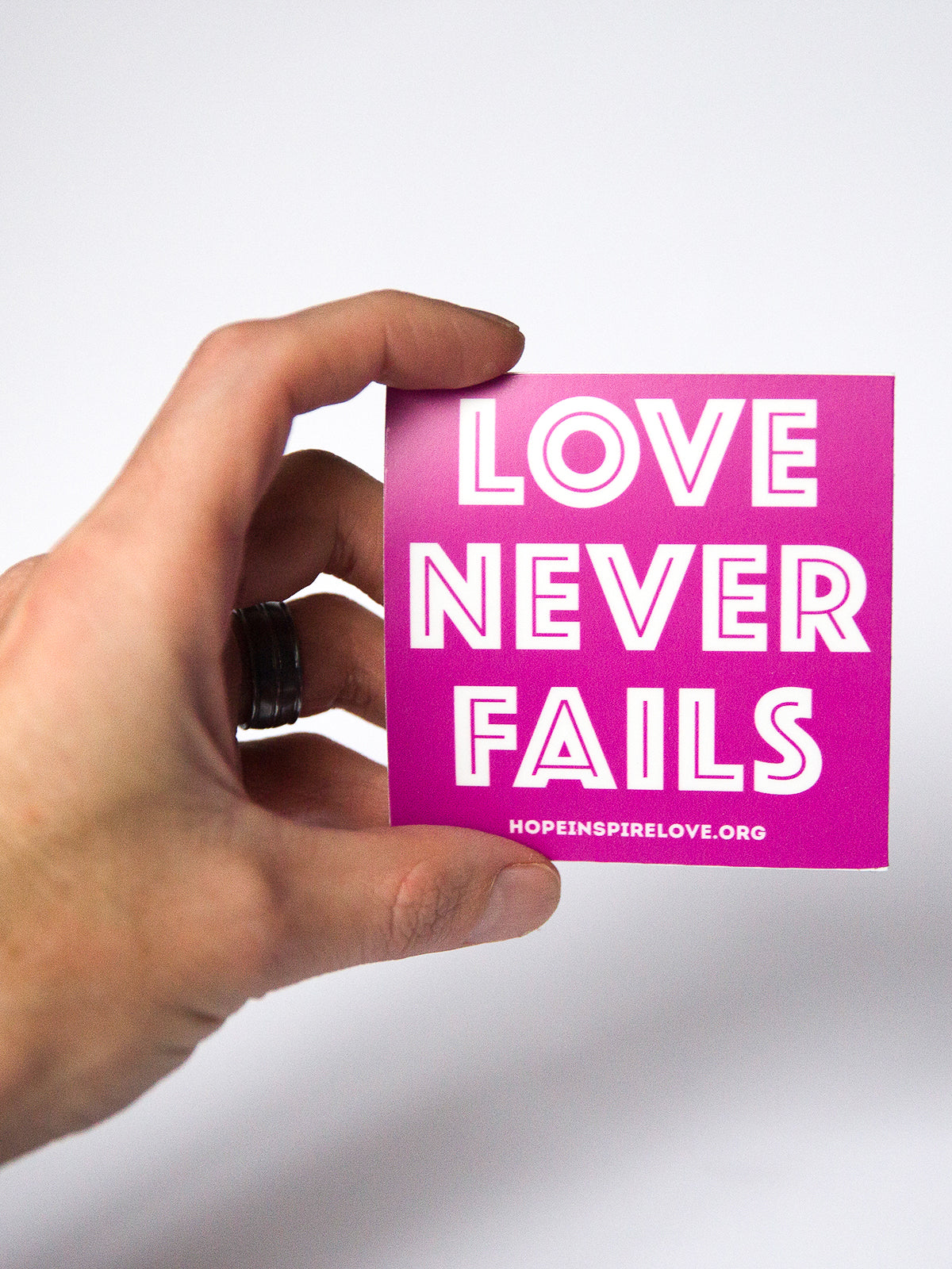 Love Never Fails Sticker - Magenta
