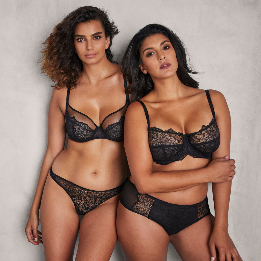 Two models wearing pieces from the Liberté Bowery Collection. The Bowery Mesh Plunge Bra with Bowery Scalloped Thong is on the left and the Bowery Lace Demi Bra with Bowery Scalloped Hipster on the right.