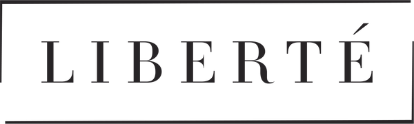 Logo for Liberté, a premium lingerie brand based in New York City. Liberté has two brackets around it forming an incomplete outline.