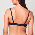 Back view of model wearing a midnight blue Liberté Crosby Plunge Bra featuring a Crosby performance micro jersey band.