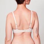 Back view of model wearing a blush pink Crosby Plunge Bra featuring a Crosby performance micro jersey band.