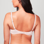 Back view of model wearing a Blush pink Liberté Crosby Demi Bra featuring a Crosby performance micro jersey band.