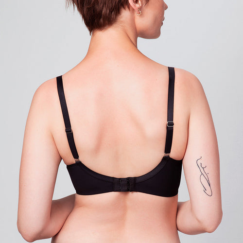 Back view of model wearing a black Liberté Crosby Demi Bra featuring a Crosby performance micro jersey band.