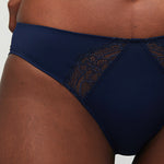 Model wearing a Liberté Crosby Scalloped Cheeky in midnight blue, featuring Crosby performance micro jersey and lace insets.