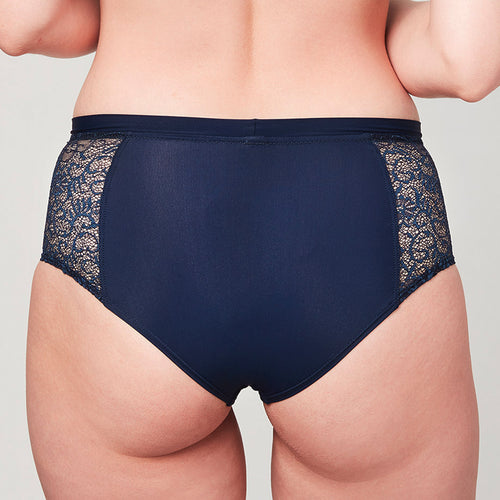 Back view of model wearing a Liberté Crosby High Rise Brief in midnight blue featuringCrosby performance micro jersey and lace insets.