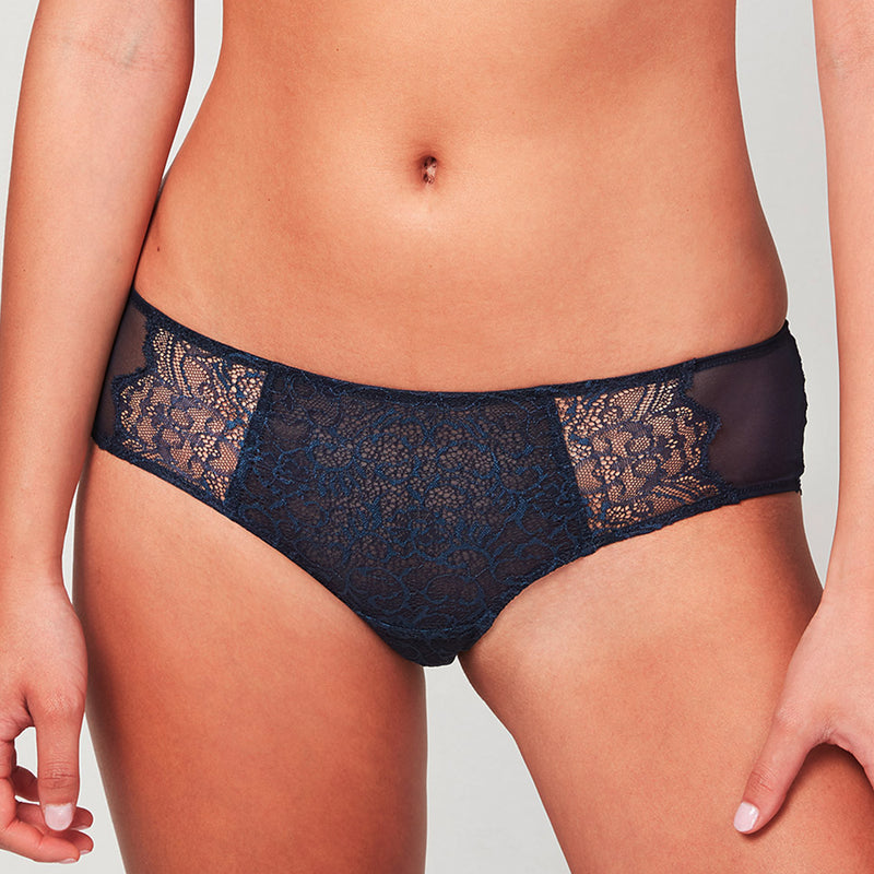 Model wearing a Liberté Bowery Scalloped Hipster, with a semi sheer lace front and sheer mesh sides in midnight blue.