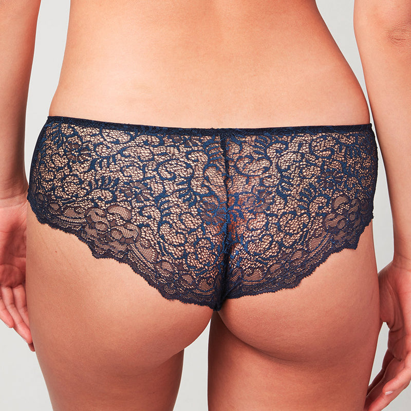 Back view of model wearing a Liberté Bowery Scalloped Hipster featuring a sheer allover lace with scalloped edges in midnight blue.