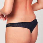 Back view of model wearing a Liberté Bowery Mesh Thong, with a semi sheer mesh back in midnight blue