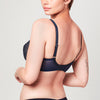 Back view of model wearing Midnight blue Liberté Bowery Mesh Plunge bra featuring a sheer power mesh band.
