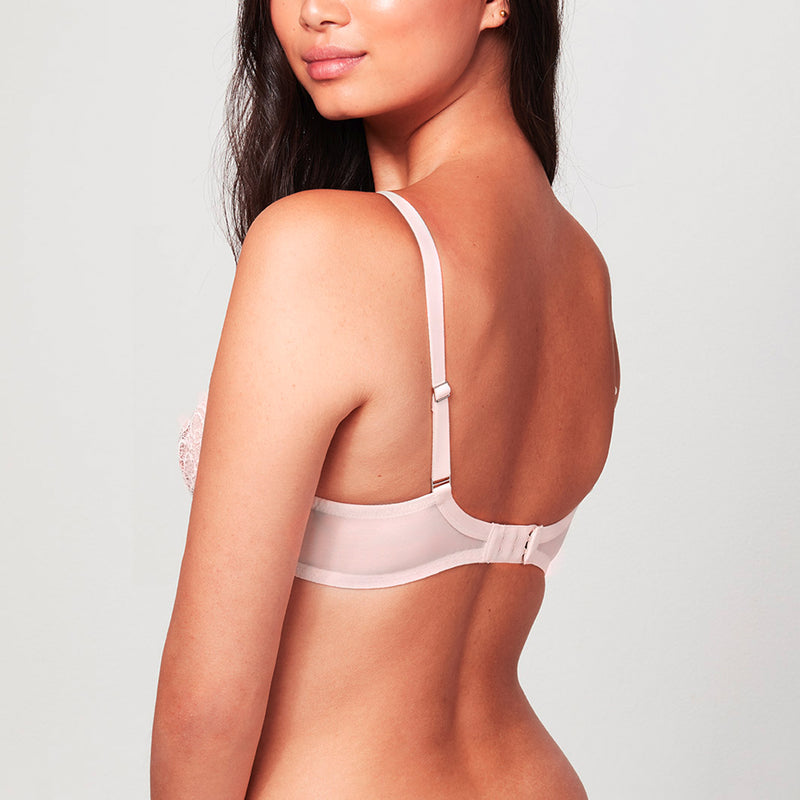 Back view of model wearing Blush pink Liberté Bowery Mesh Plunge bra featuring a sheer power mesh band.
