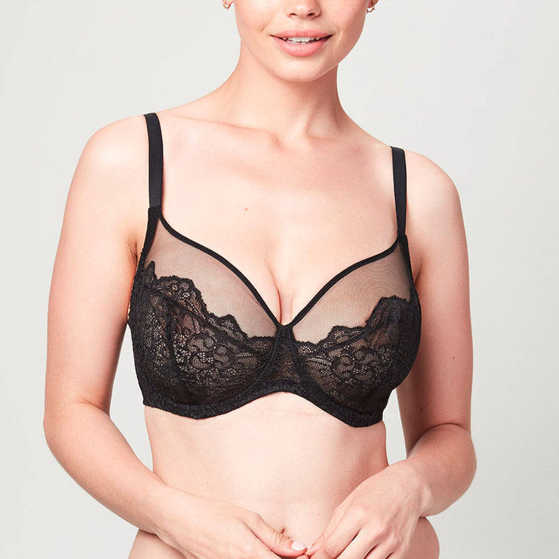 Model wearing a black Liberté Bowery Mesh Plunge bra featuring a 3 piece cup with sheer mesh at the neck line.