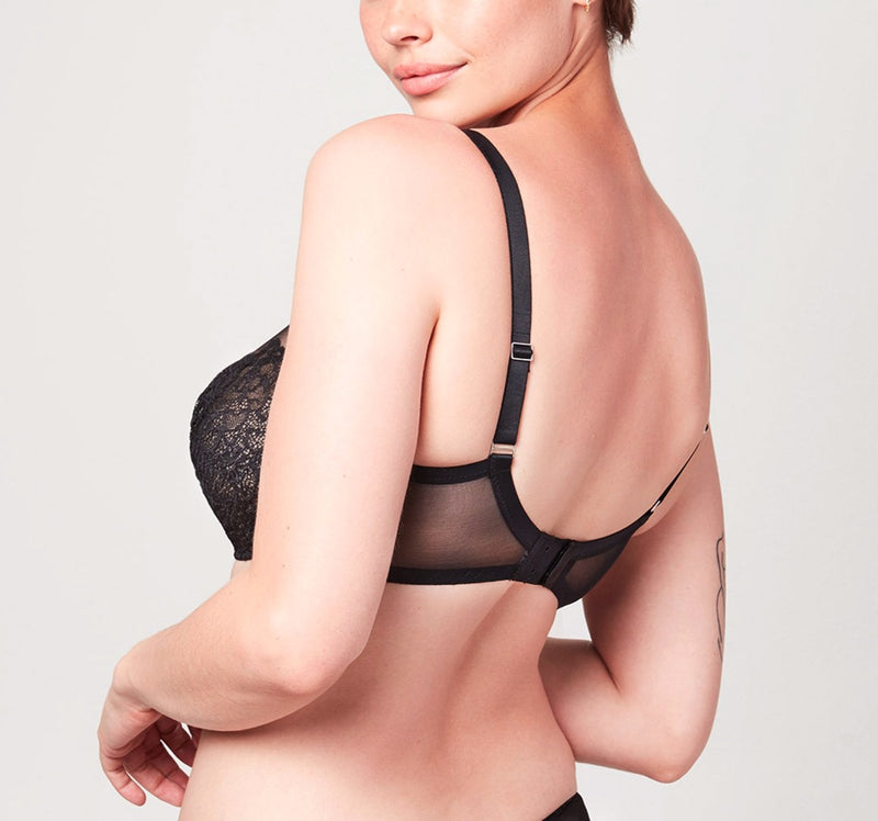 Back view of model wearing a black Liberté Bowery Mesh Plunge bra featuring a sheer power mesh band.