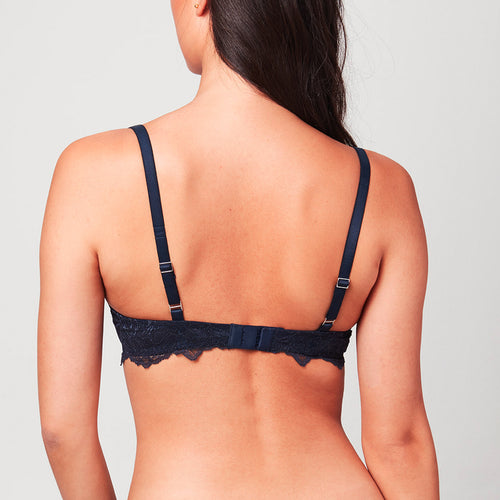 Back view of curve model wearing a Midnight blue Liberté Bowery Lace Demi Bra with scalloped edges on the band
