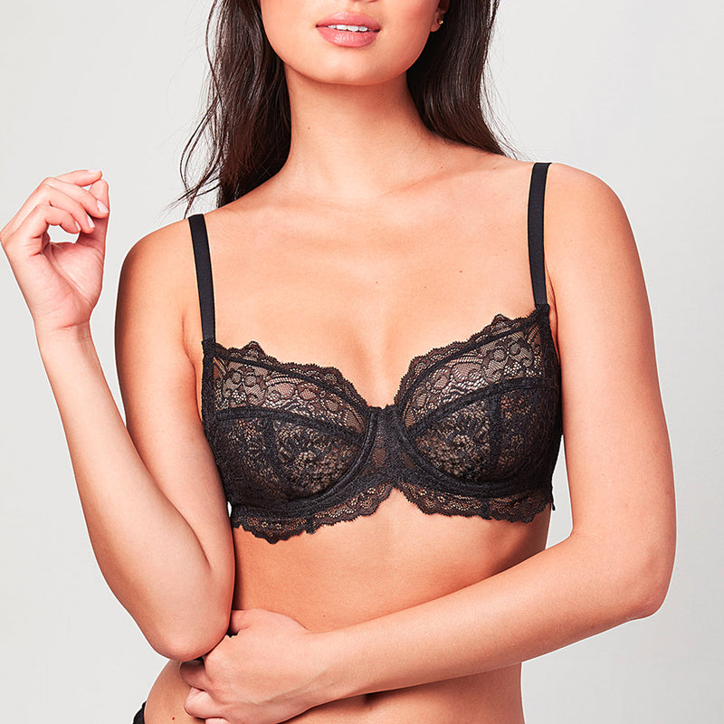 Model wearing a black Liberté Bowery Lace Demi bra featuring a 3 piece cup and all over sheer lace with scalloped edges.