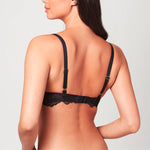 Back view of model wearing a black Liberté Bowery Lace Demi Bra with scalloped edges on the band