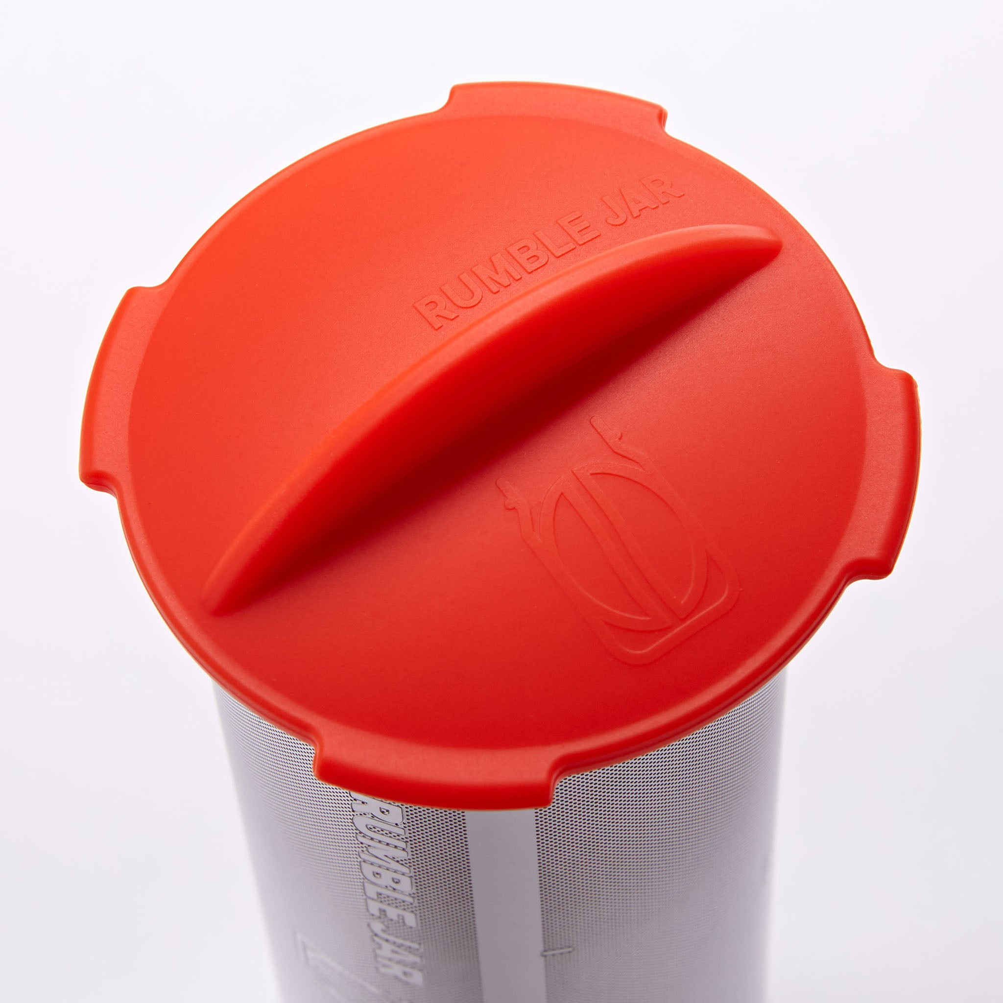 Rumble Jar's silicone cap in the orangey-red color