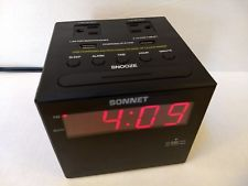 Charging Station Clock Radio 2 110 volt Plugs and 2 USB Ports