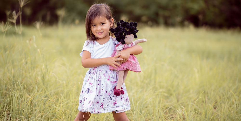 Girl with Bonikka Doll playing in a field