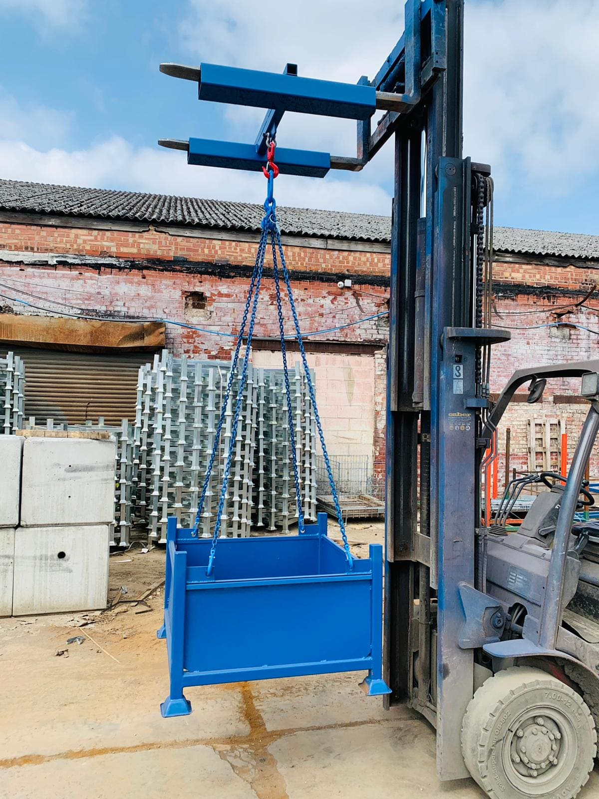 Image of stillage being lifted by forklift crane