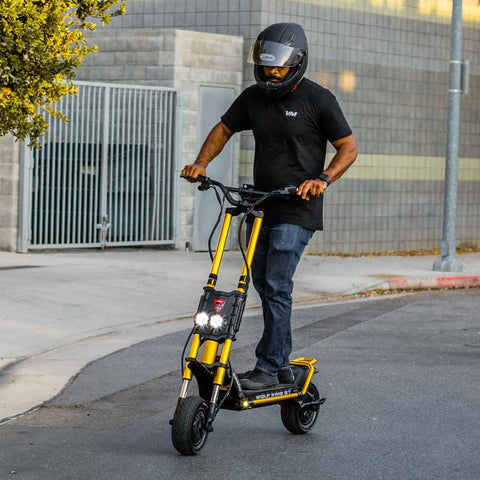 Man riding Wolf King GT electric scooter