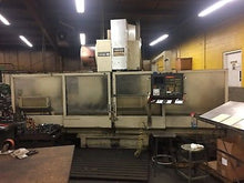 "Toshiba CNC, 63"" x 34"", CAT-50 
