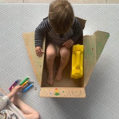 Totter and Tumble Cardboard box play