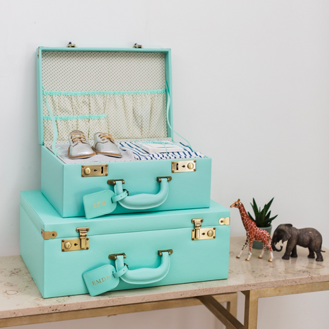 bright turquoise memino memory boxes for children and parents to safe keep memories mini suitcases stacking home decor
