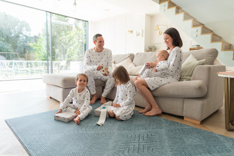 totter and tumble wanderlust bold design padded playmat with didi and bud family wearing matching pyjamas PJs