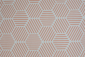 close up of coral hexagon luxury memory foam one piece Totter and Tumble playmat