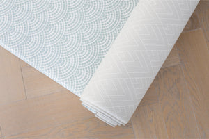 Totter and tumble luxury playmat in neutral blue scalloped design with reversible grey padded play mat