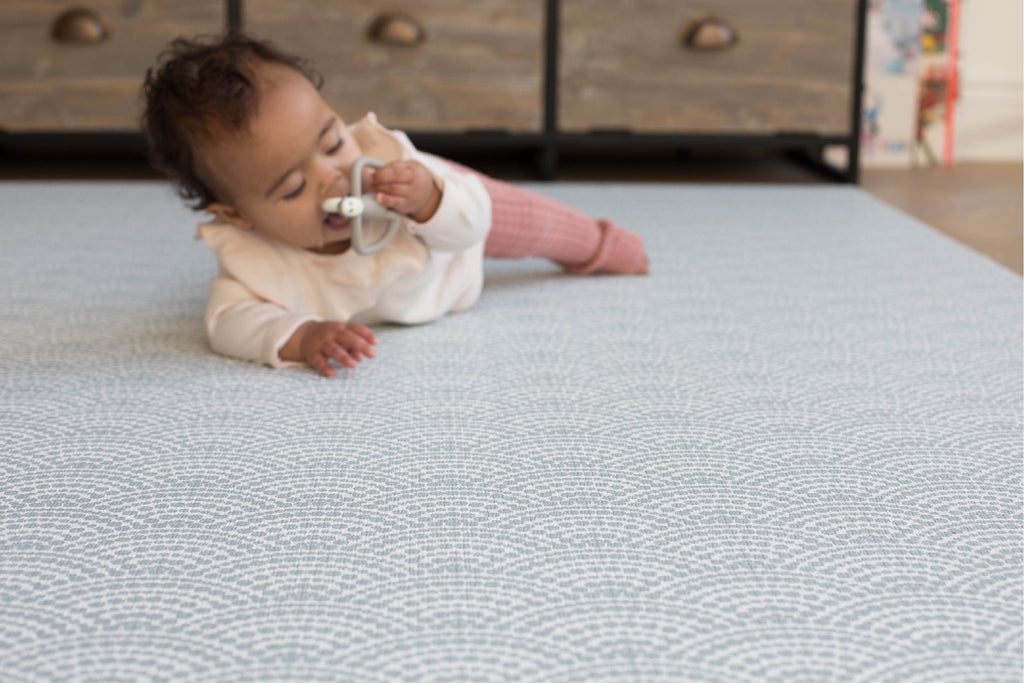 Totter and tumble stylish baby playmat in neutral blue scalloped reversible memory foam play mat