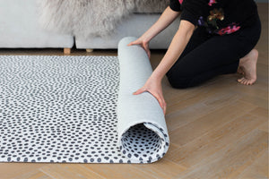 Totter and tumble The Scout and Wanderer are luxury reversible playmats monochrome stylish play mat for kids