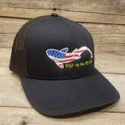Midnight blue fly fishing stars and stripes fish hat embroidered with the American flag inside the shape of a swimming fish, with high on the fly USA underneath.