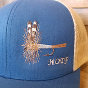 detailed image of brown and grey embroidered Adams fly on blue Snapback hat