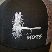 detailed image of grey embroidered Adams fly on black Snapback hat