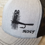 detailed image of black embroidered Adams fly on grey Snapback hat