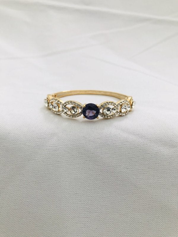 Elegant cz stones with purple stone side lock bracelet - Globus Fashions