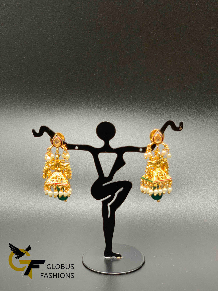 Traditional peacock design with pearls jumka earrings