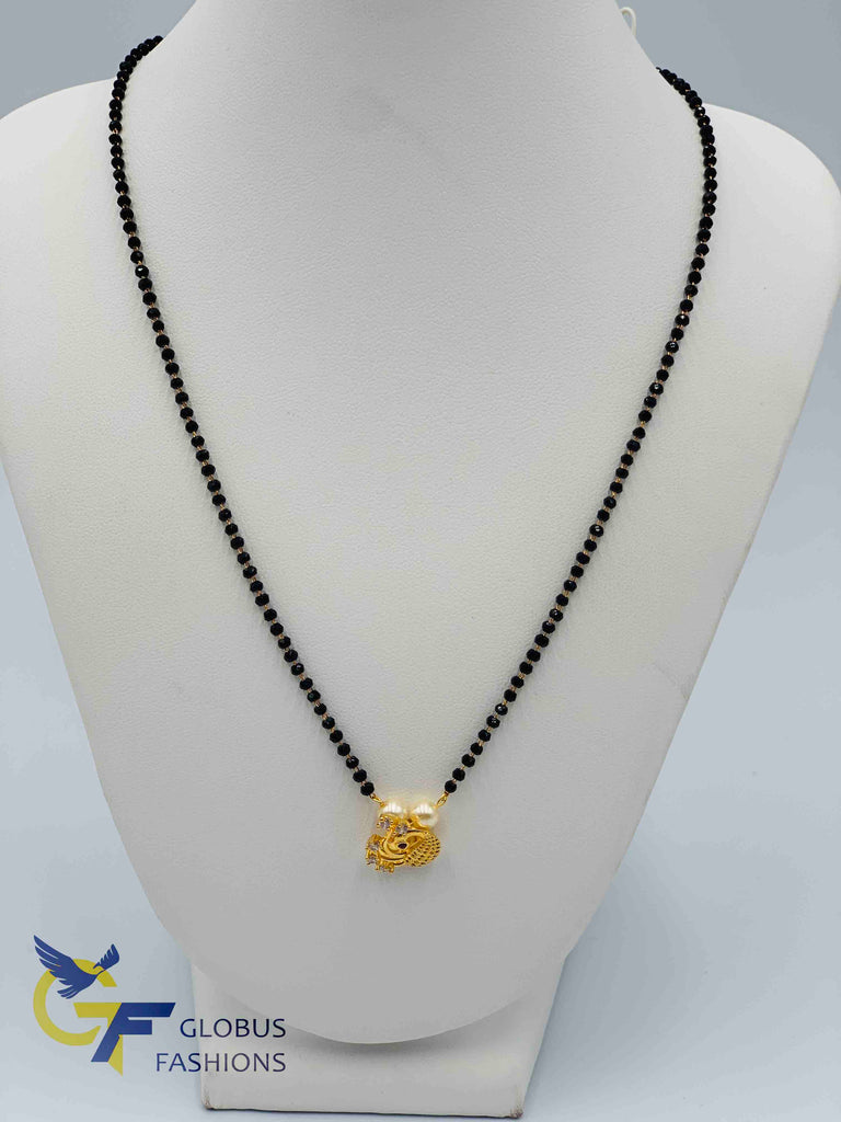 Traditional look Peacock design pendant with a single line black diamond beads chain
