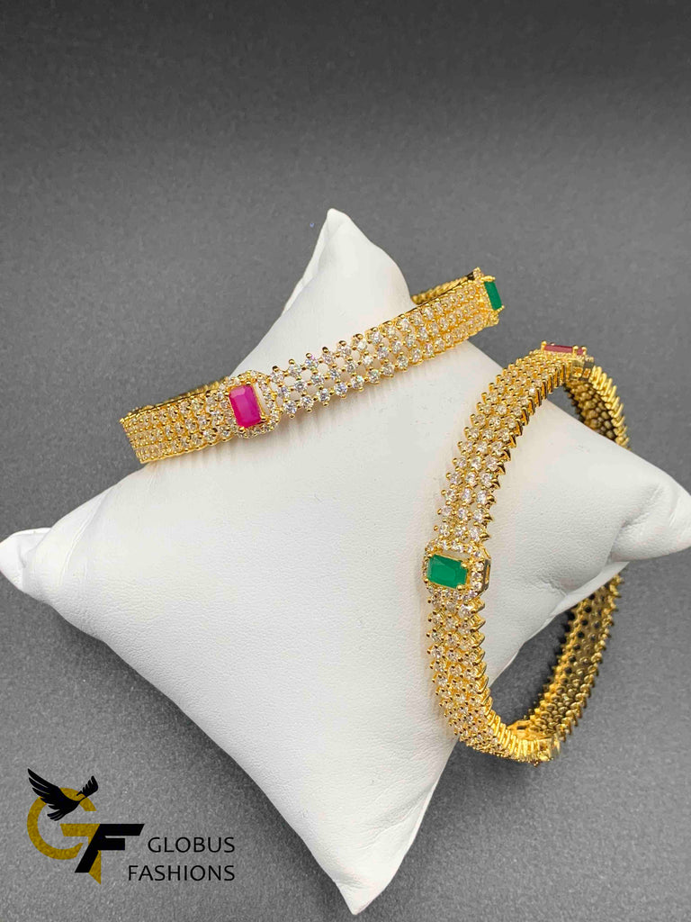Cz stones and square-shaped ruby and emerald bangles