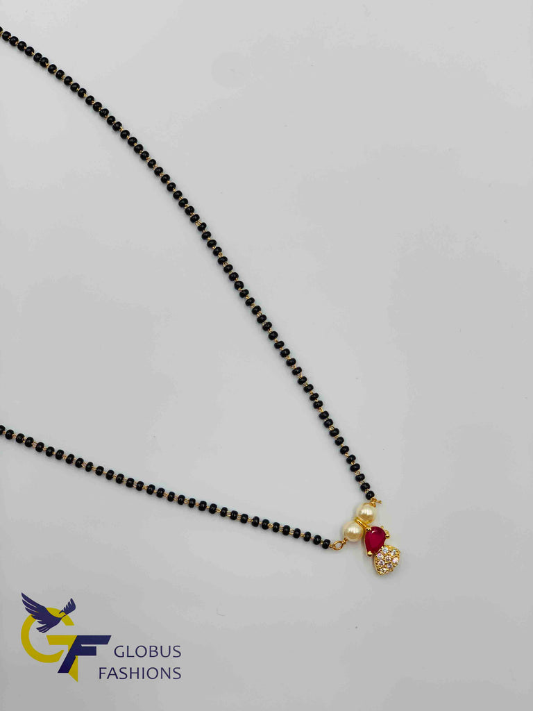 Small cz and ruby stones pendant with a single line black beads chain