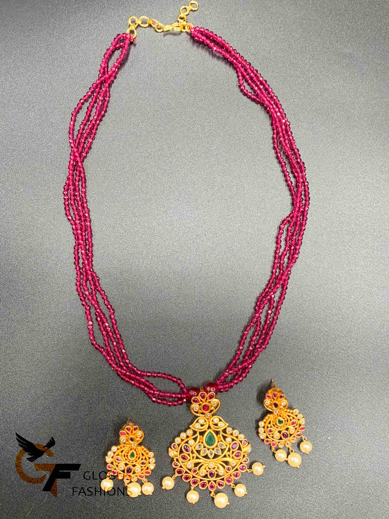 Pink color beads with a traditional and antique look multi-color stones pendant and matching earrings