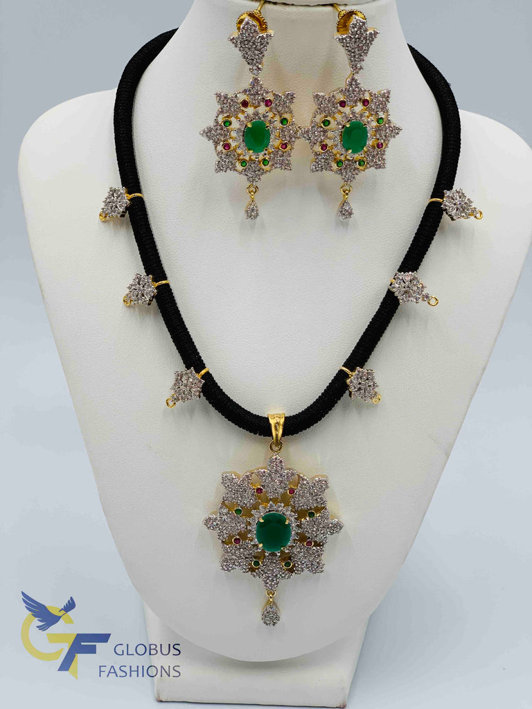 Cz stones and emerald stones pendant and earrings with black thread chain