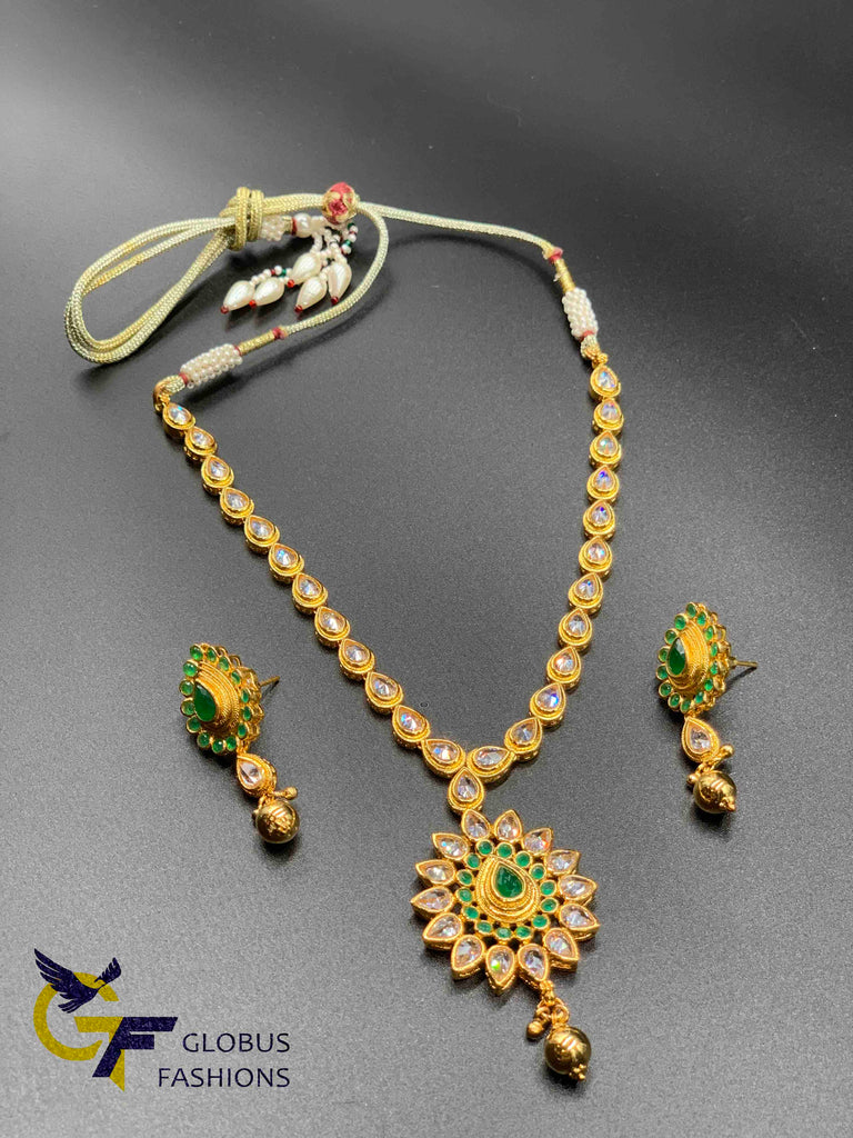 Cute polki stones and emerald stones necklace set